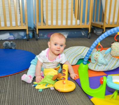 Baby playing with toys on the floor