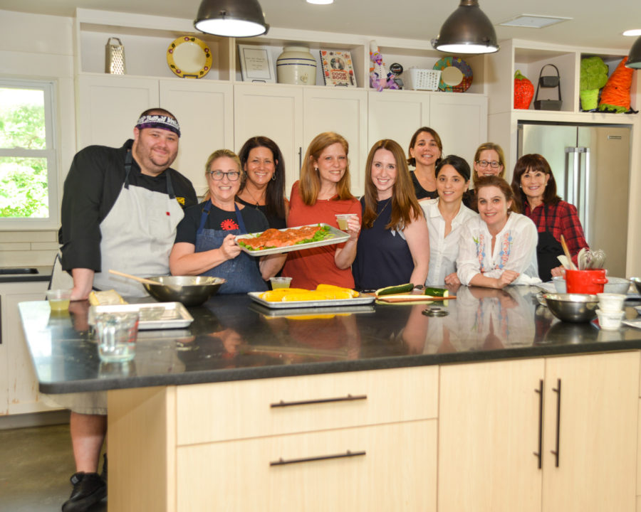 Group of adults taking a cooking class