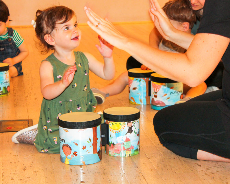 Young girl with beginner drums
