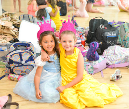 Two girls dressed up as princesses