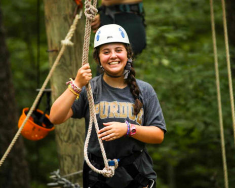 Girl camper on ropes course