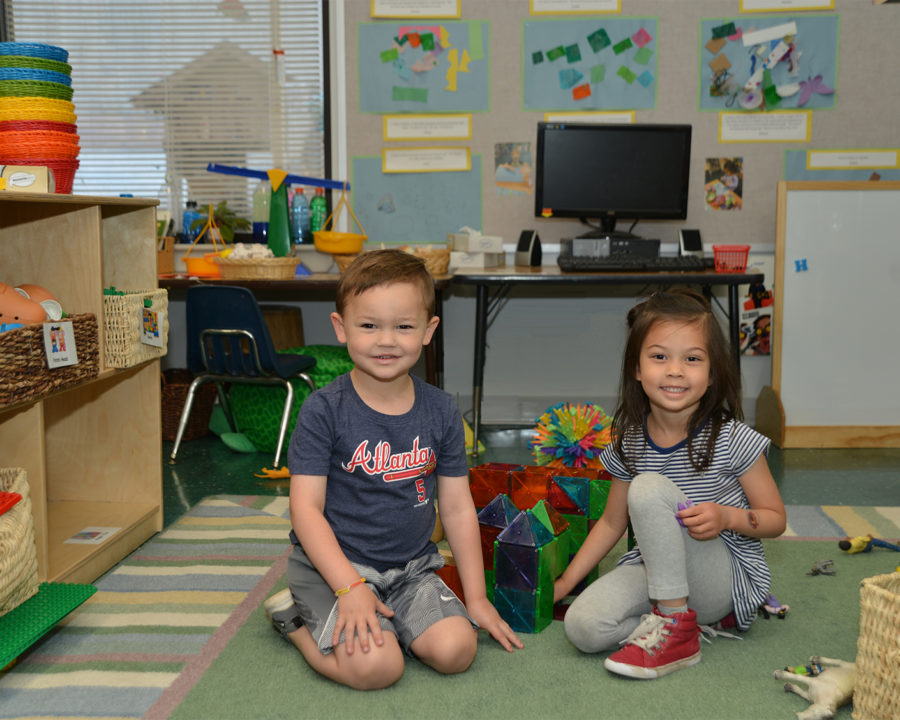 Two preschool kids playing together