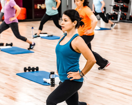 Woman lunging in an exercise class