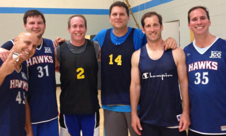 four adults at basketball