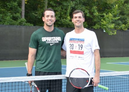 Two men holding tennis rackets at ALTA tennis