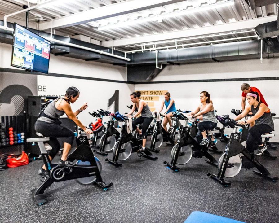 Group cycling in a Indoor Cycling Class