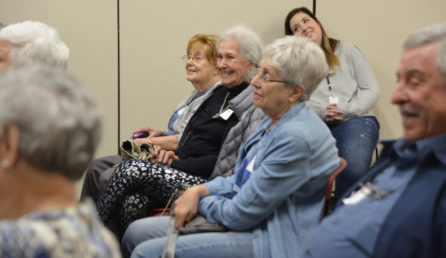 Seniors listening at a discussion group