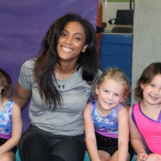 staff and youth at gymnastics