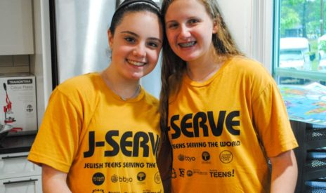 Two girls smiling at a J-Serve International Day of Service event