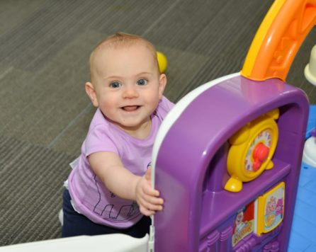 Baby playing at the Kid Zone Drop-off Childcare program