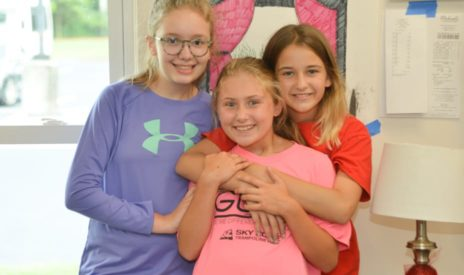 Three girls hugging at MJCCA Day Camps