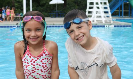 Two young kids in a pool at the MJCCA Day Camps