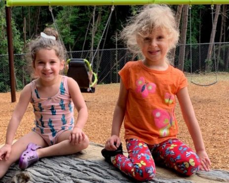 Two young girls sitting at MJCCA Schiff School (Sandy Springs) - Preschool Summer Camp