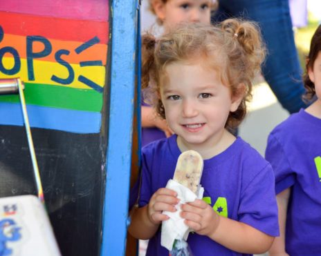 Girl holding snack at MJCCA Schiff School (Sandy Springs) - Preschool Summer Camp