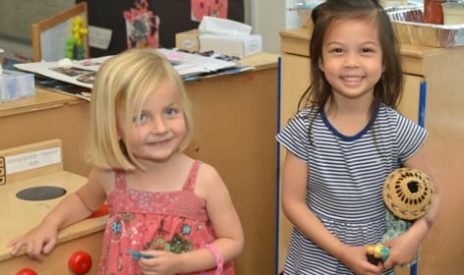 Two young children playing indoors at the Preschool Summer Camps (Infants-PreK) program