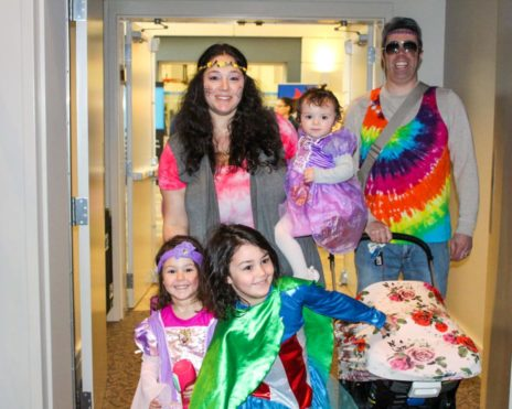 Kids and adults wearing Purim costumes