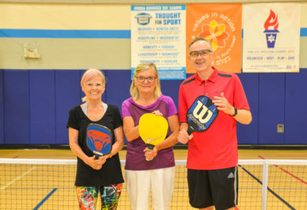 Seniors playing pickleball