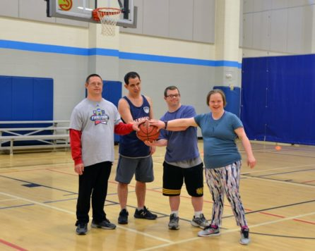 People with special needs holding a basketball