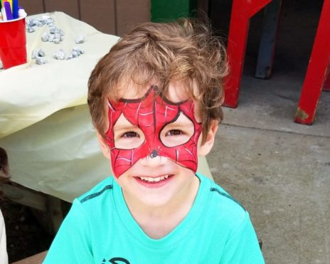 Young boy with spider man face paint