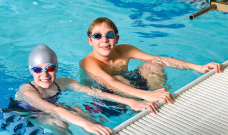 two teens in the pool at aquatics