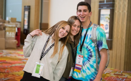 Three teens smiling at a teen convention