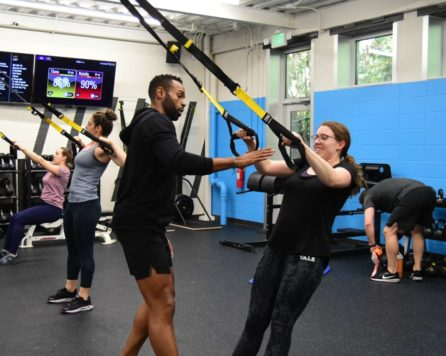 Instructor and student in a Ultimate Fitness Classes