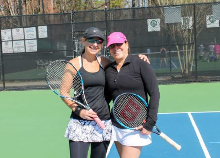 Two women holding tennis rackets at USTA tennis