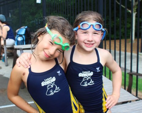 two girls smiling while at Sharks swim team