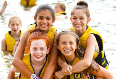 girls in life jackets